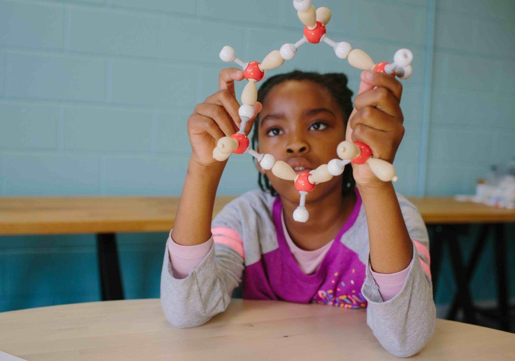 Girl holding STEM Curriculum Molymod molecule